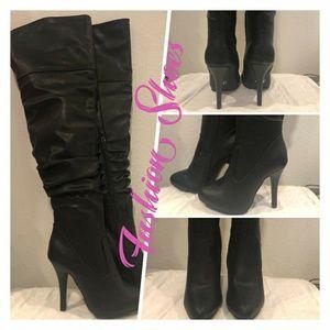 Thigh high black stiletto boot